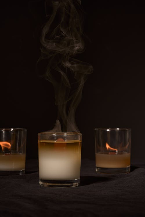 Transparent burning wax aroma candles in studio