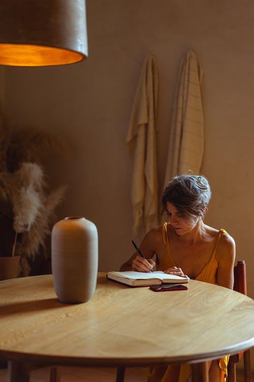 Elderly Woman Busy Writing