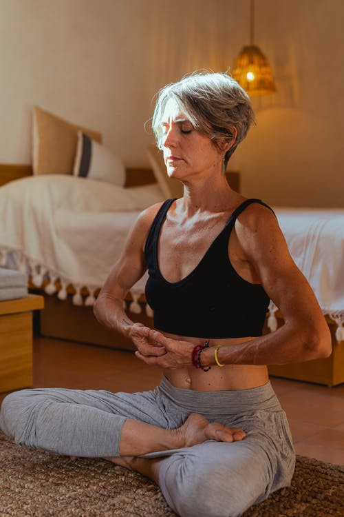 Elderly Woman Meditating