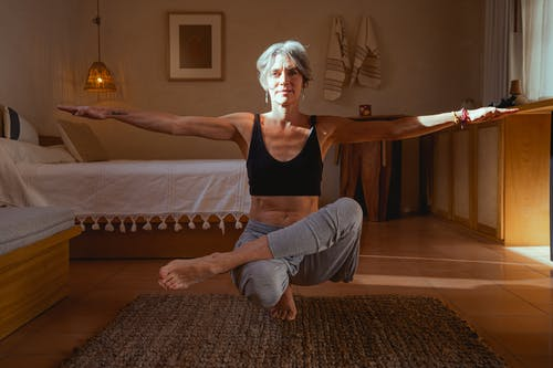 Elderly Woman Meditating Inside the Room