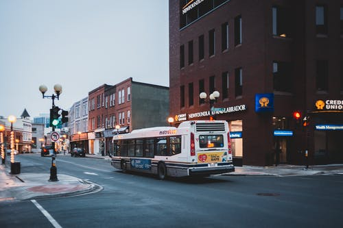 City street with bus driving on asphalt road