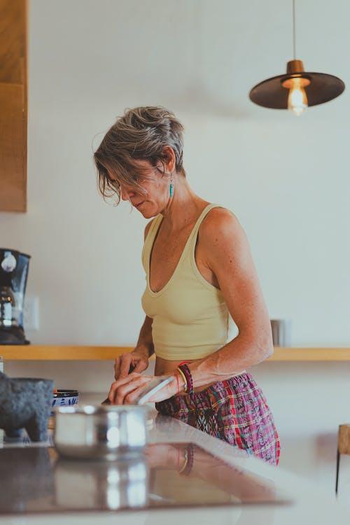 Elderly Woman Preparing Her Breakfast
