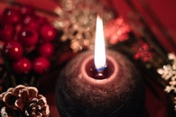 Lighted Black Round Candle