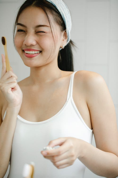 Happy Asian woman with toothbrush