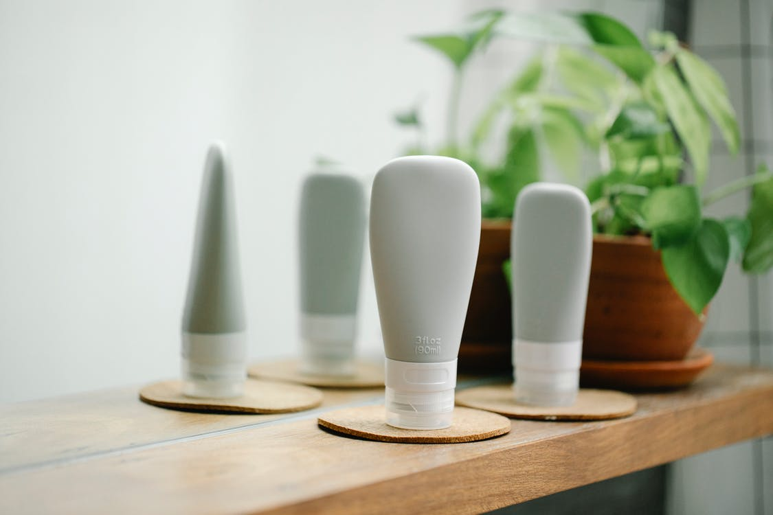 Tubes of essential supplies for beauty care in room