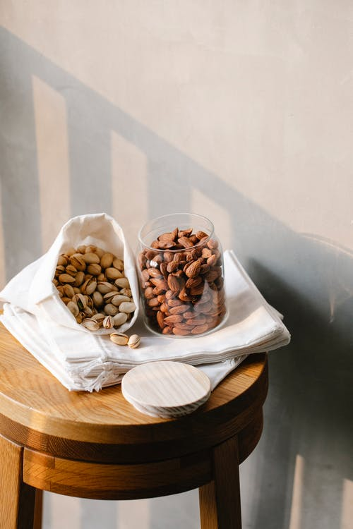Delicious nuts on wooden table