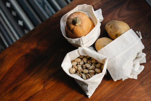White sacks with vegetables and nuts