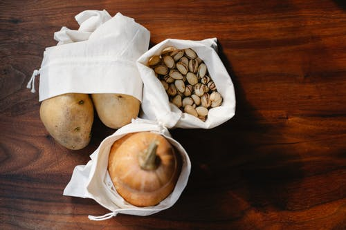 Vegetables and nuts in bags