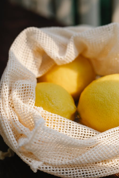 Pile of lemons in mesh bag