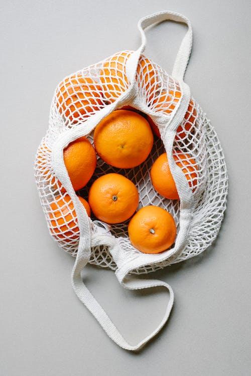 Orange Fruits on White Mesh Basket