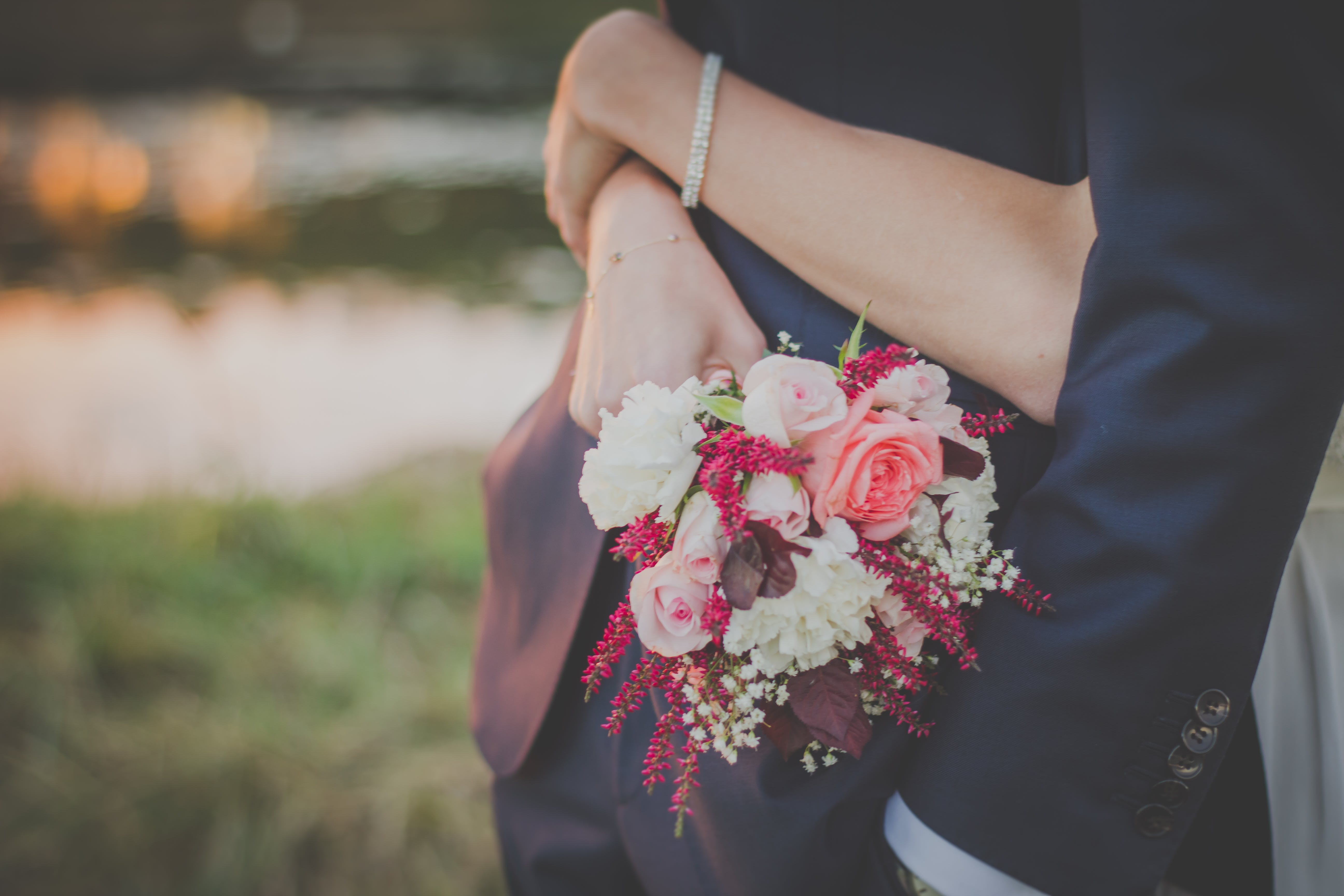 Person Holding a Bouquet of Flower