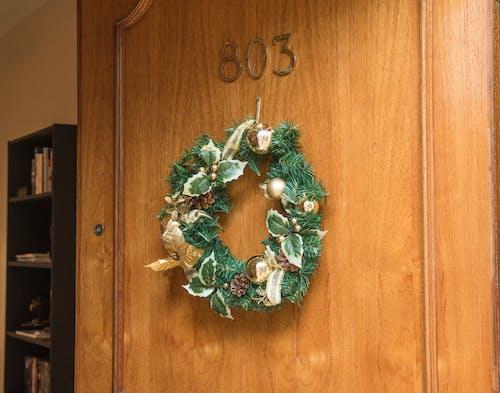 Christmas Wreath Hanging on Brown Wooden Door of Room 803