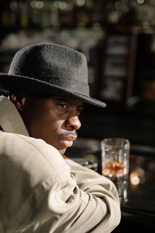 Close-Up Photo of Man Wearing Black Fedora Hat
