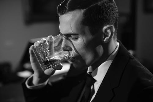 Close-Up Photo of Man Drinking Whiskey