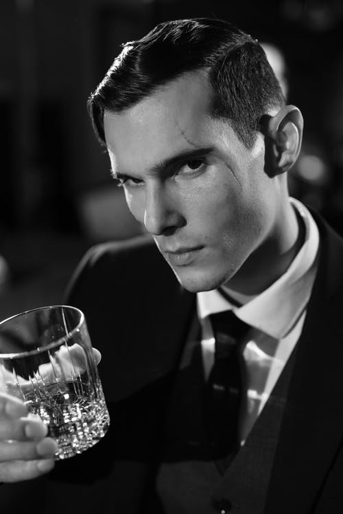Close-Up Photo of Man Holding Clear Drinking Glass