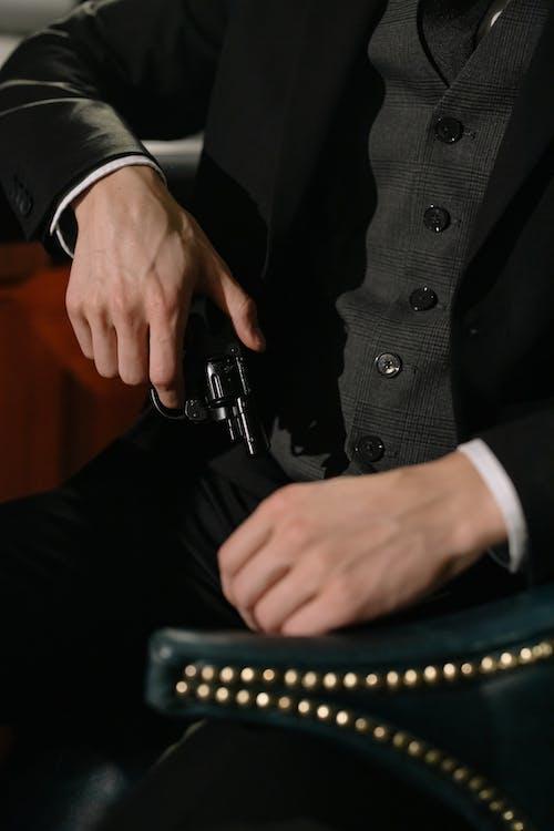 Man in Black Suit Jacket and Black Pants