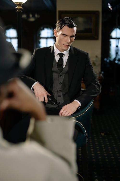 Photo of Man in Black Holding a Gun