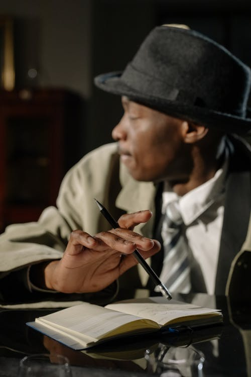 Photo of Man Holding Black Pen
