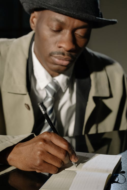 Photo of Man Taking Down Notes