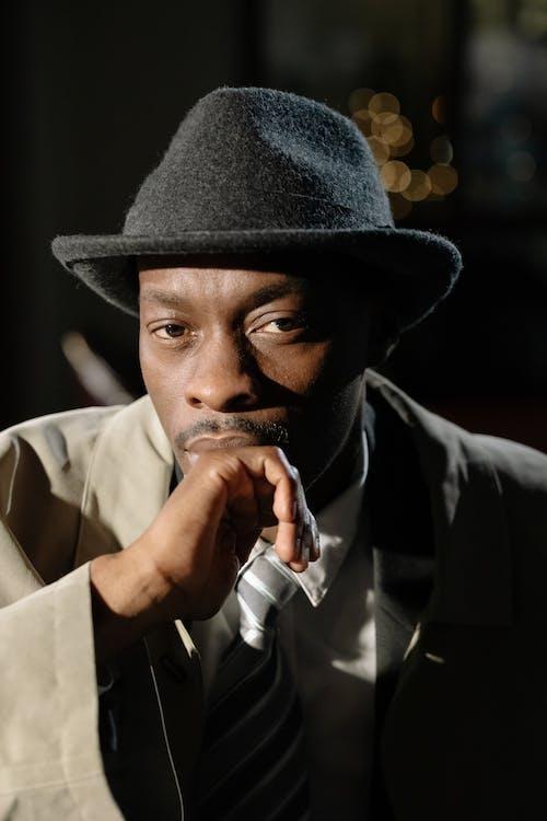 Photo of Man Wearing Black Fedora Hat