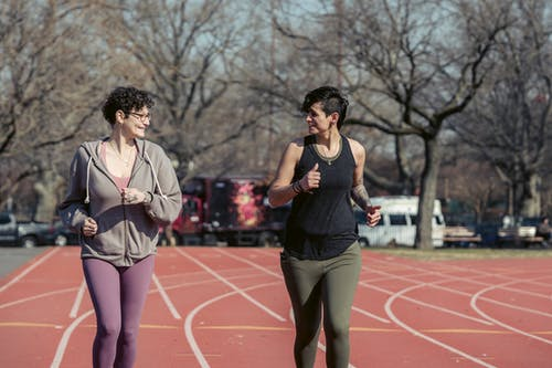 Young fit women jogging on stadium