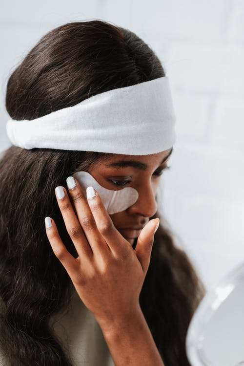 Woman Covering Her Face With White Textile