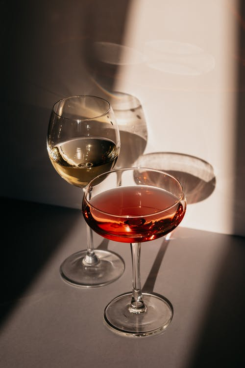 Assorted alcohol drinks in elegant glasses placed on table