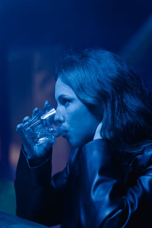 Sideview of a Woman Drinking From a Glass