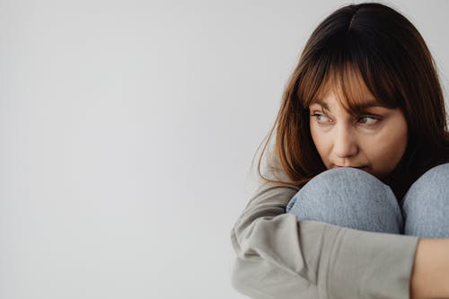 Close-Up Shot of a Woman Hugging her Knees