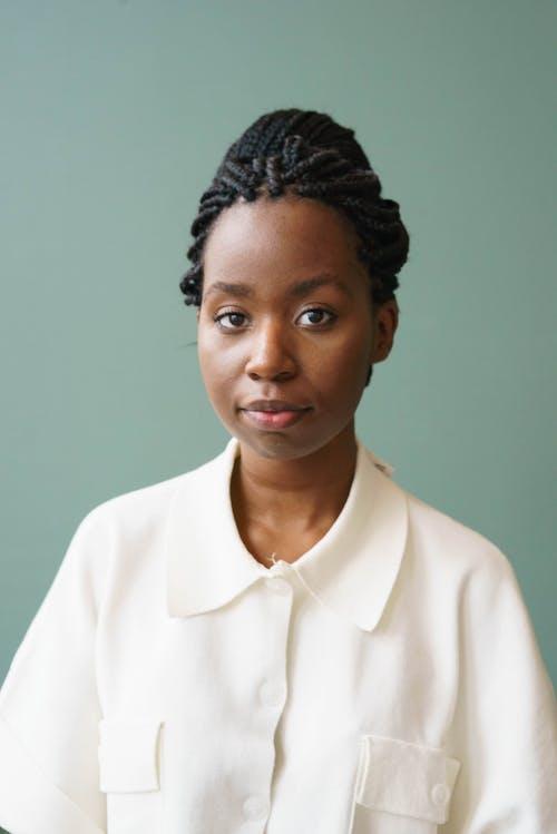Stylish ethnic model in blouse on gray background
