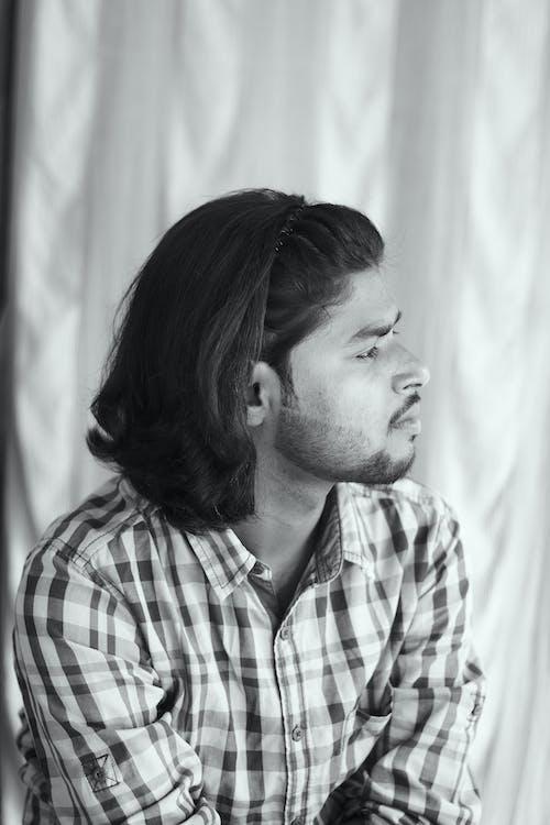 A Grayscale Photo of a Bearded Man