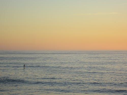 Gratis arkivbilde med hav, himmel, sjø, solnedgang