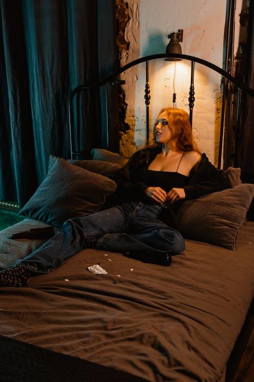 Woman in Black Dress Lying on Bed