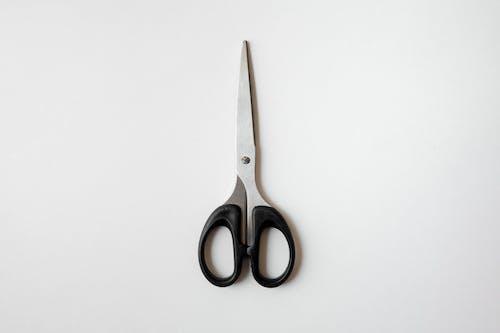 Black Handled Scissors on White Table