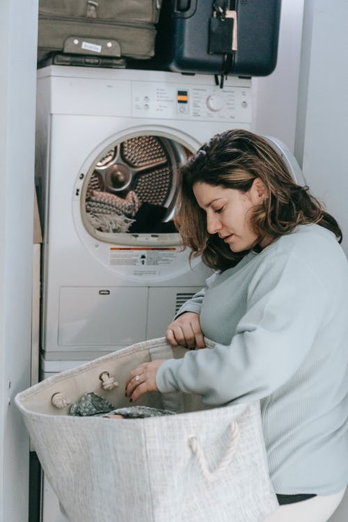 Woman choosing clothes for for washing