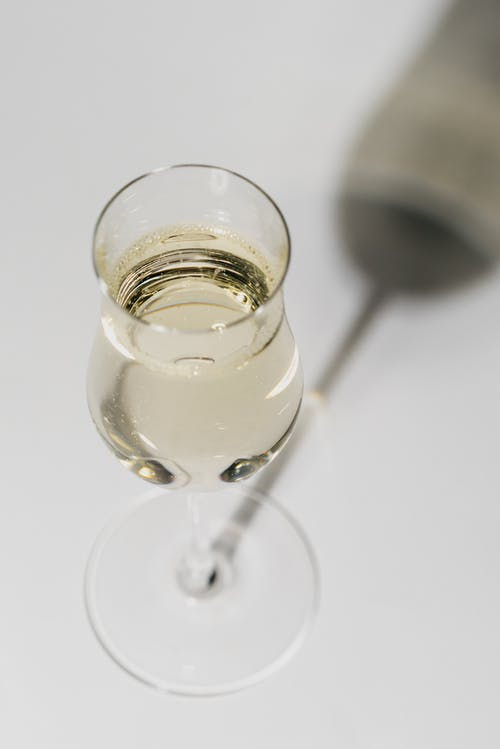 Close-Up Shot of a Glass of White Wine