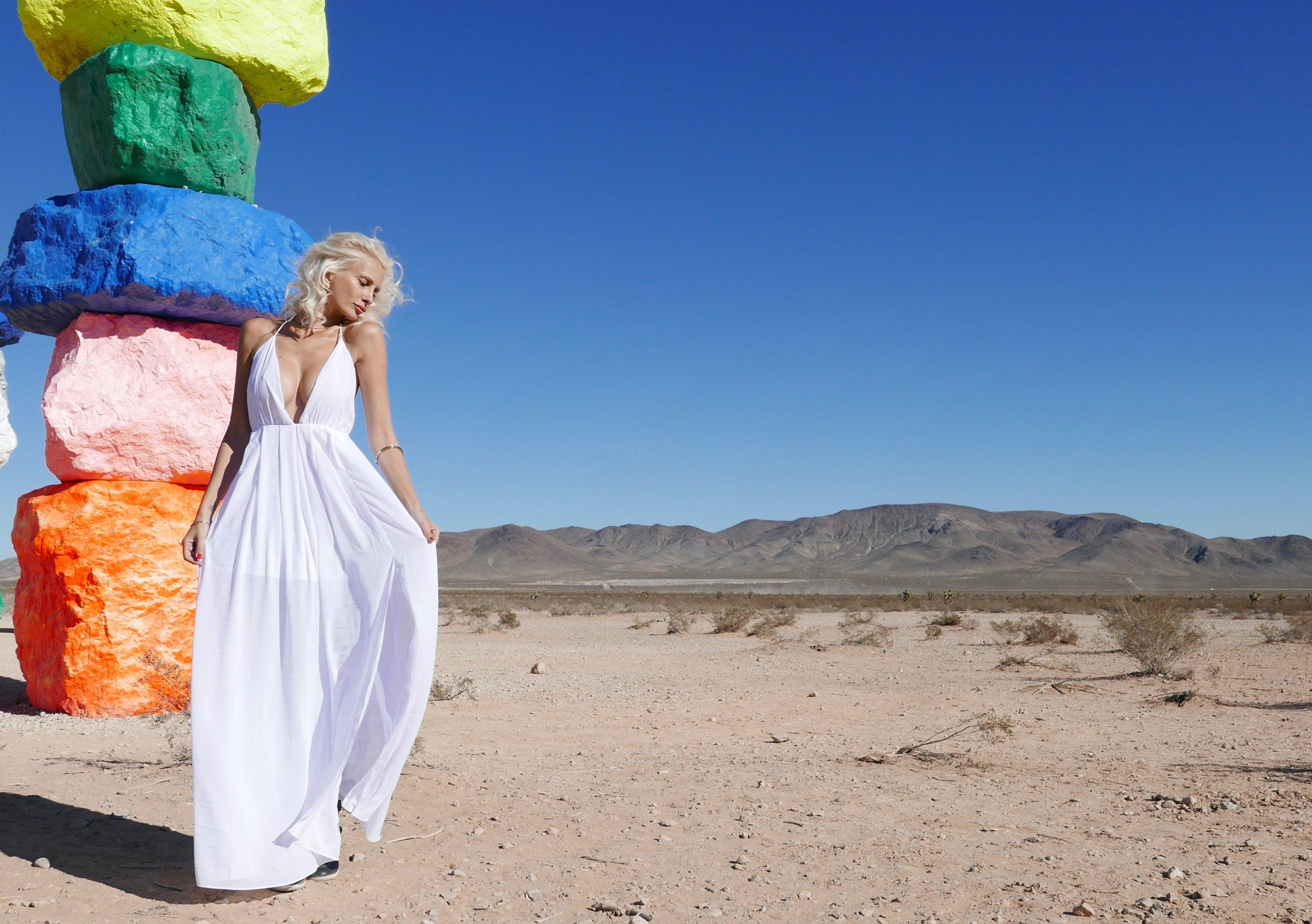 Woman in White Halter Neckline Deep V-neck Dress Standing