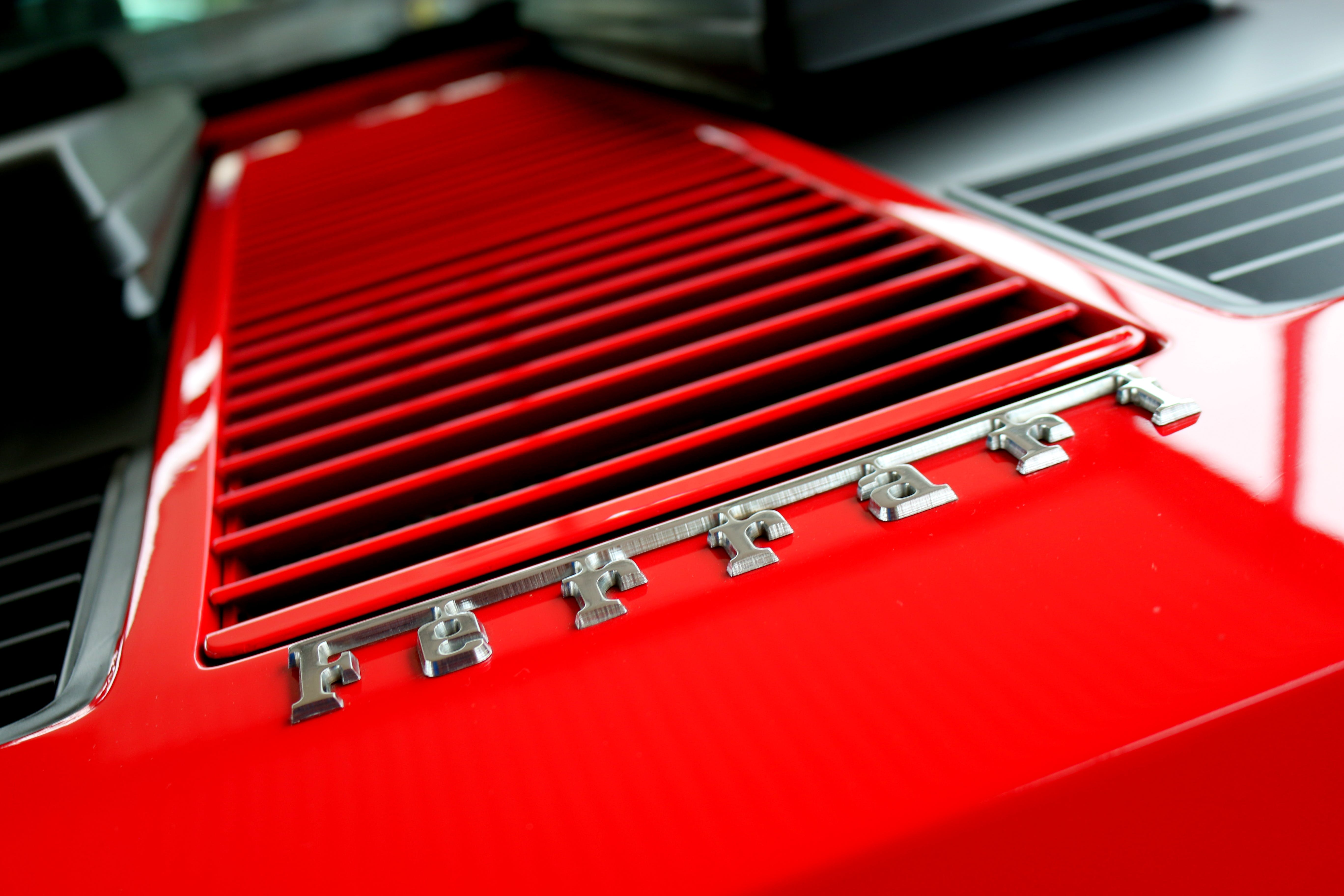 Close-up Photography of Red Metal Grille