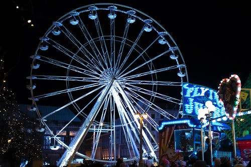 White Lighted Ferris Wheel in Amusement Part