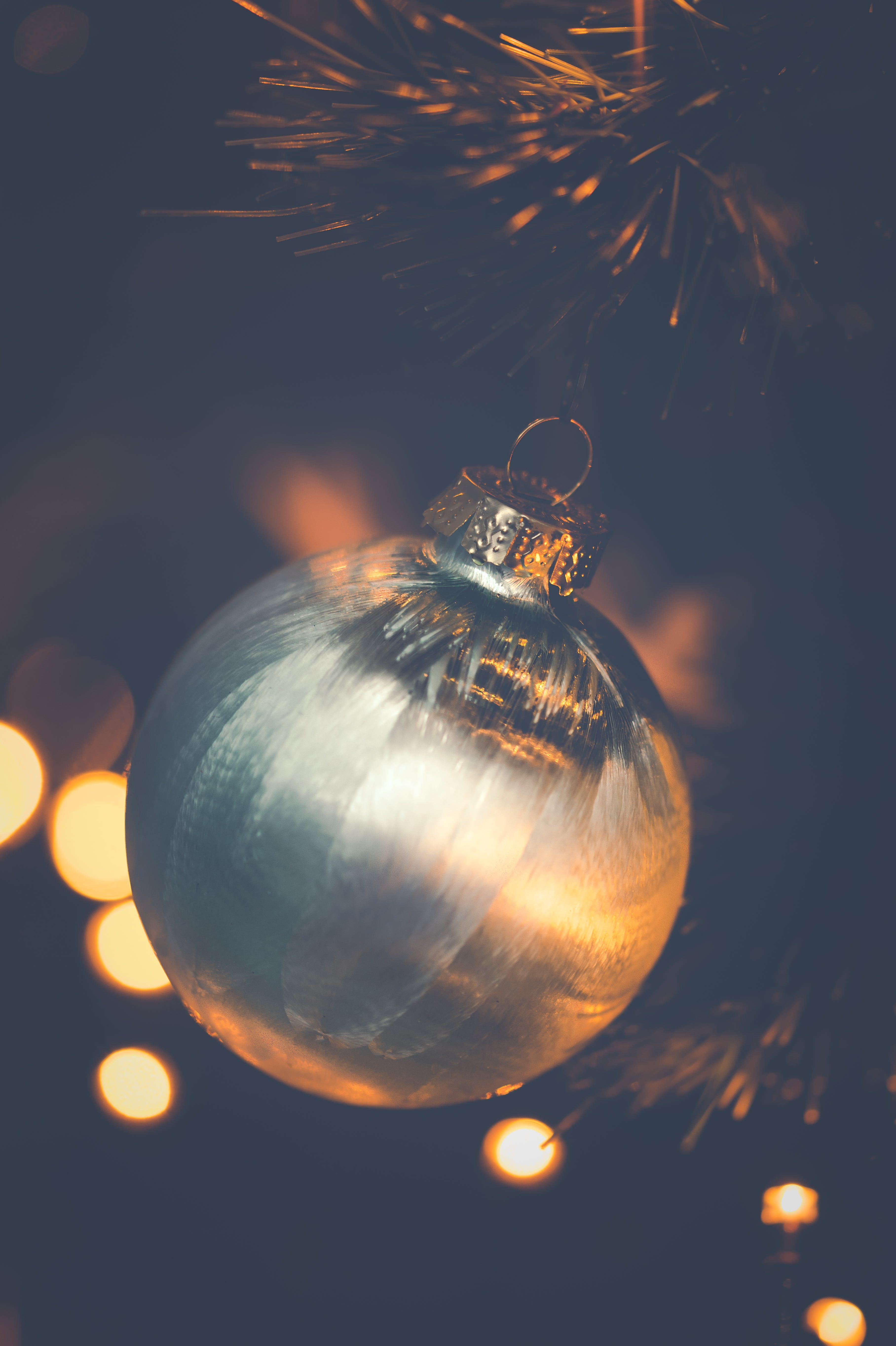 Shallow Focus Photo of Silver Bauble