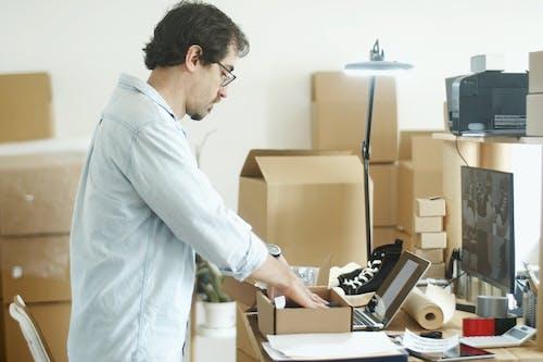 Man Putting Item on the Box