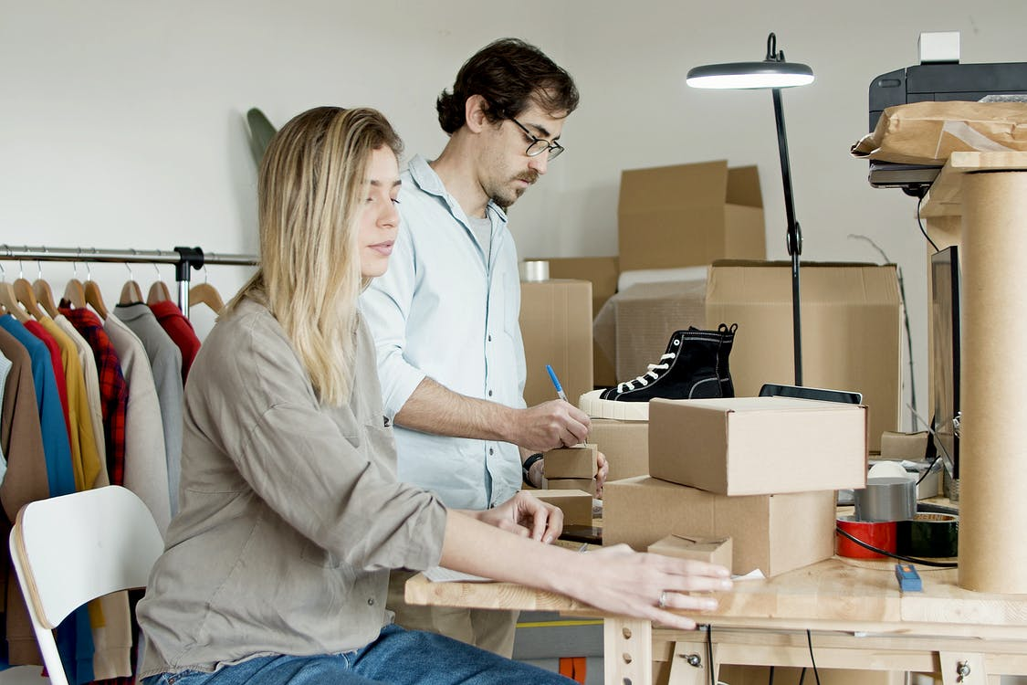Couple Busy with Packaging Their Products