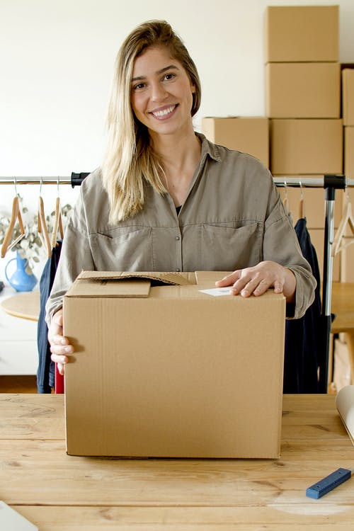 Woman Smiling while Holding the Package