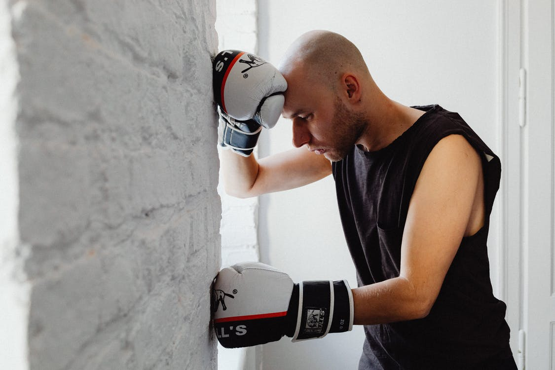 A Man Wearing Boxing Gloves