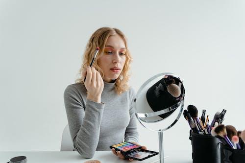 Woman Holding Eye Makeup Brush