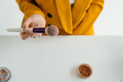 Hand with Make Up Brush