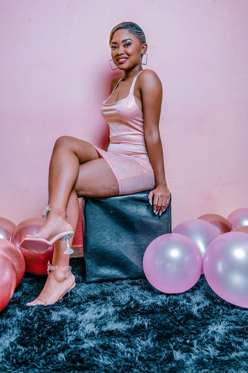 Woman in Pink Tank Top Dress
