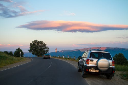 Free stock photo of car, clouds, road
