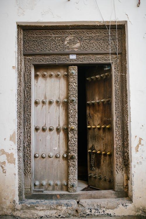 Shabby door of old house in street