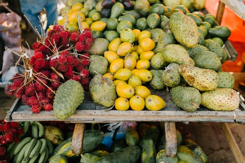 Assorted tropical fruits on stall at market